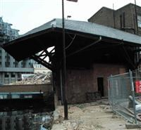Wharf side shelter and store to rear of builders' merchants, 22, Praed Street W2 - Westminster, City of