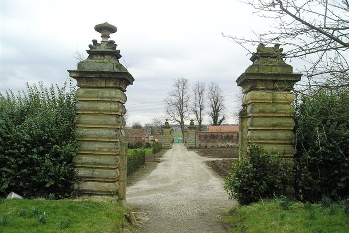 Walled garden gate piers to Central north-south Lane, Henderskelfe