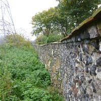 Portion of wall on the west side of River Pickle between Merton High Street and Merantun Way, High Street, Wimbledon Village SW19 - Merton