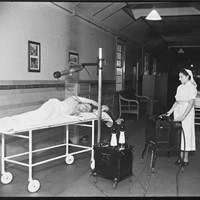 A radiographer operating the mobile radiography and X-ray equipment
