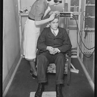 Attaching electrodes to a patient's head, St Hugh's Military Hospital (Head Injuries), St Margaret's Road, Oxford, Oxfordshire