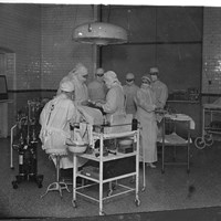 Navy nurses at work in the operating theatre, Royal Naval Hospital, Windmill Road, Chatham, Medway