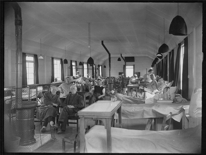 A view of a ward in a hut, London Hospital annexe, High Wood Hospital, Brentwood, Essex