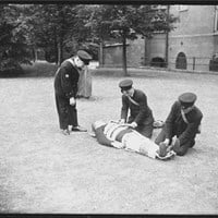 Students practising the use of a Neil Robertson stretcher, Royal Naval Hospital, Windmill Road, Chatham, Medway