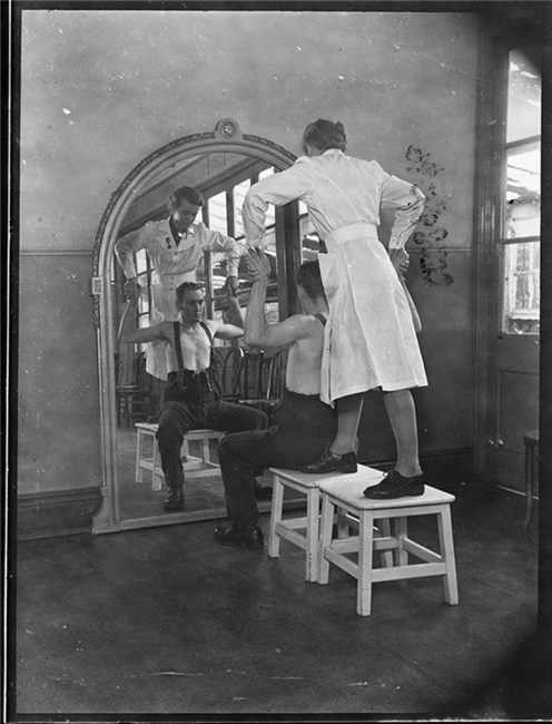 A physiotherapist giving remedial exercises, Wharncliffe Emergency Hospital, (part of) Middlewood Hospital, Sheffield