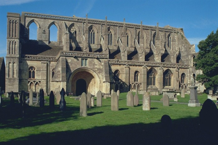 A nunnery was first documented here in 603. A monastery was founded during the abbacy of Aldhelm (c675-705). It became Benedictine in the reign of Edgar (959–975) and remained so until dissolved in 1539. The final Abbey Church was built circa 1160-70 and had 13th/14th and 15th century additions. The 431 feet (131 m) tall spire,  collapsed in a storm around 1500. The west tower fell around 1550. As a result of these two collapses, less than half of the original building stands today. The abbey was closed at the Dissolution of the Monasteries in 1539 by Henry VIII. It was sold, with all its lands, to William Stumpe, a rich merchant. He gave the abbey church to the town for continuing use as a parish church, and filled the abbey buildings with twenty looms for his cloth-weaving enterprise.  More Info