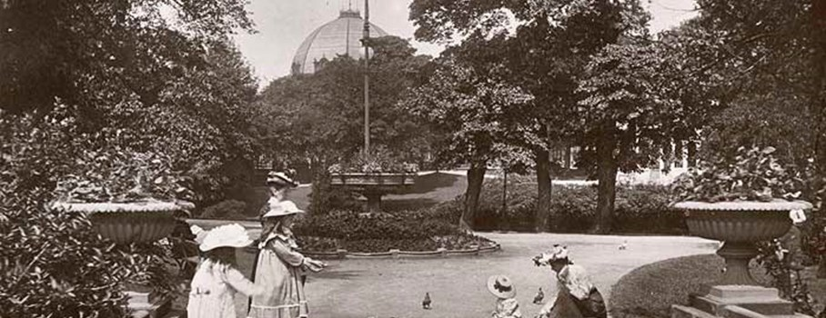 Girls feeding pigeons in the gardens with the pavilion in the background. The Buxton Pavilion Gardens were created between 1869 and 1871. They were designed by an Edward Milner. He was the apprentice of the renowned garden designer Joseph Paxton. Paxton is best known for designing the 'Crystal Palace' in London.