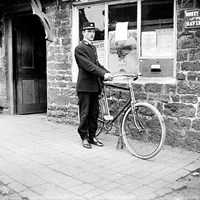 A postman and his bicycle,  Byfield, Northamptonshire