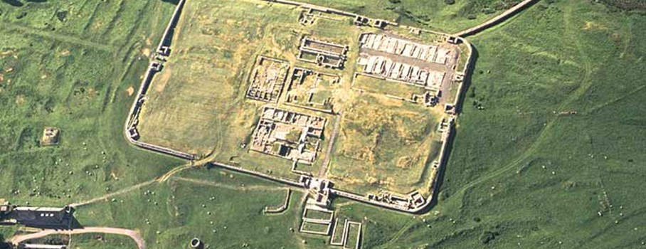 An aerial view of Housesteads Fort.  Its Roman name 'Vercovicium' means 'The Place of Fighters'.  It was one of a chain of forts built along Hadrian's Wall. This site is now in the care of English Heritage (2010).  Read detailed archaeological description.