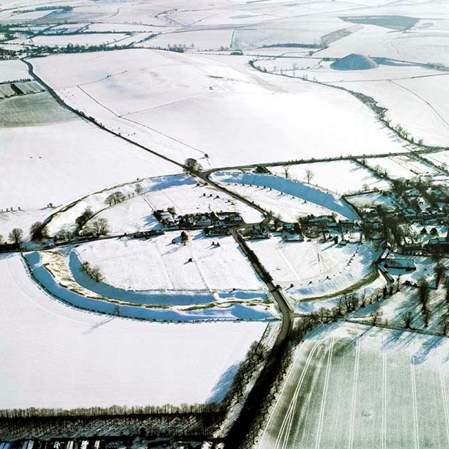 Avebury and Silbury Hill in the snow, Avebury, Wiltshire