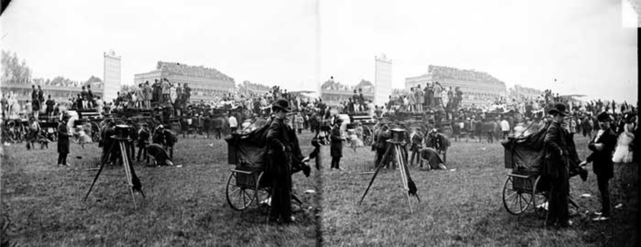 The famous racecourse at Ascot is pictured here in the late 19th century. To the left of the picture is a camera on a tripod; taking pictures of the race goers has always been as much a part of Ascot as the race itself. In the background the pavilion is packed with people hoping to get lucky on the horses. A picture of the racecourse today may well show nearly as many top hats as seen here.