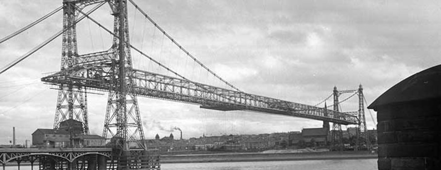 View of the Widnes and Runcorn Transporter Bridge from the shore. It was opened in 1905 and was the largest bridge of this type ever.  It was demolished after 1961 when a new high level road bridge was built.
