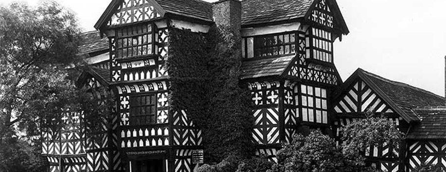An exterior view of the timber-framed Little Moreton Hall in Cheshire.  This gentleman's residence dates from the early 15th century to around 1600.  It originally had a moat and was built around a courtyard.