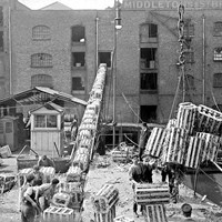 Unloading crates at Butlers Wharf, London