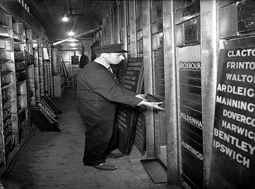 Changing the departure boards at Liverpool Street Station, City of London