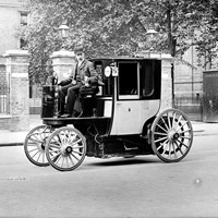 A motor cab and driver, London