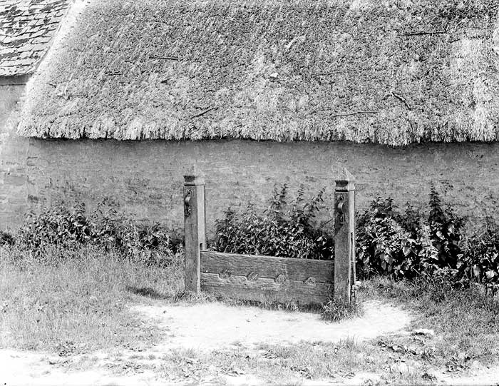 The village stocks with four ankle holes for the punishment of petty crime and misdemeanor in the village.  Although probably used from the Anglo-Saxon period, a statute of 1351 made it law for every township to provide and maintain a set of stocks.