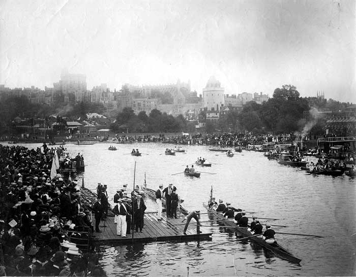 The annual Eton boating regatta on the River Thames at Windsor, with the castle buildings on the hillside in the background. The event was instituted to commemorate a visit of George III (1760-1820) and held on his birthday, 4th June.