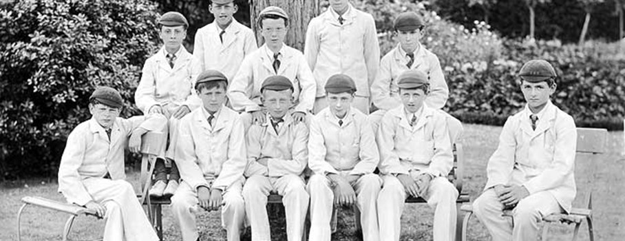 A school sports team, posing for a photograph in the grounds. The school was founded to prepare boys for Public School or the Royal Navy.