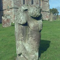Carved bear, Church of St Andrew, Dacre, Cumbria