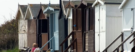 Image of colourful beach huts in Frinton-on-Sea.