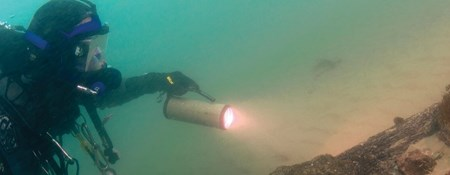 Image of a diver surveying the underwater wreck of the 'Invincible'.