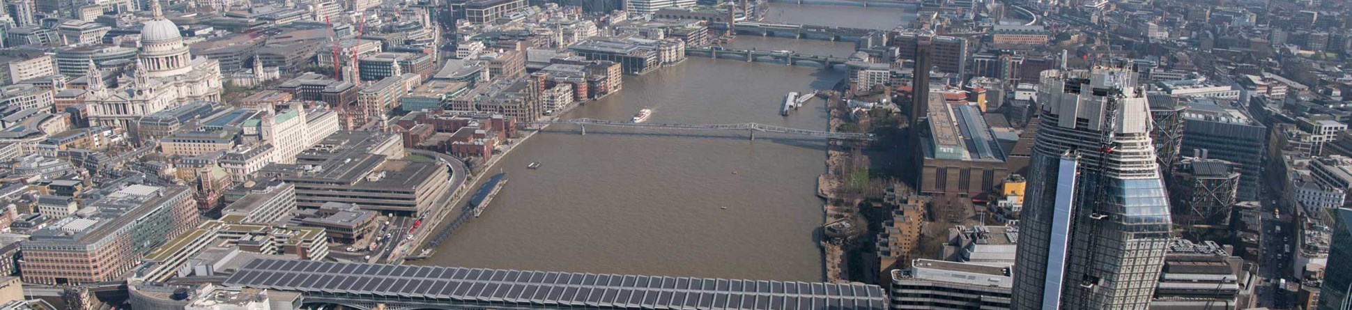 An areal view of central London along the Thames including St Pauls.