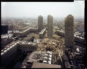 A colour photo of the Barbican arts centre in the centre from a high vantage point.