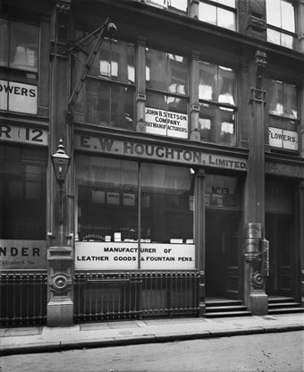 The lower front of 13 Edmund Place, showing signs for occupants of the premises E W Houghton Limited leather good manufacturers and John B Stetson hat manufacturers.