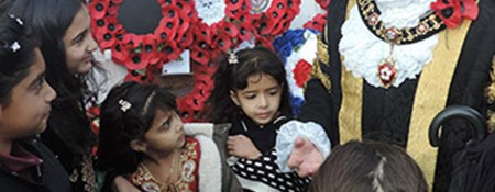Children tell the Mayor of Leicester about their work at a Remembrance Event