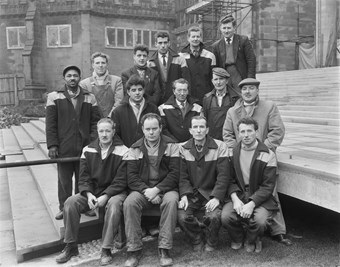 A group of male Laing employees pose for a group photo.