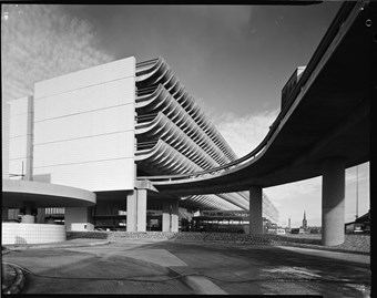 A black and white photograph of the Preston Bus Station showing the large car park building.