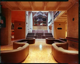 An interior photograph of the Barbican Centre showing bespoke furniture and fittings.