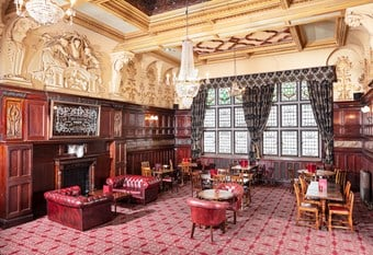 An ornate dining room within a large and imposing Victorian Public House.