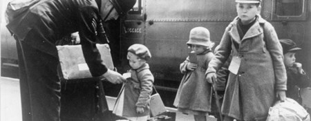 Evacuated children with policeman at London railway station IWM LN6194
