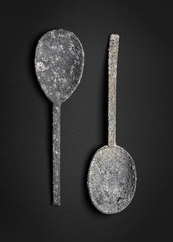 "Two pewter spoons. The one on the left has a round maker's mark and the initials ""BA"" at the base."