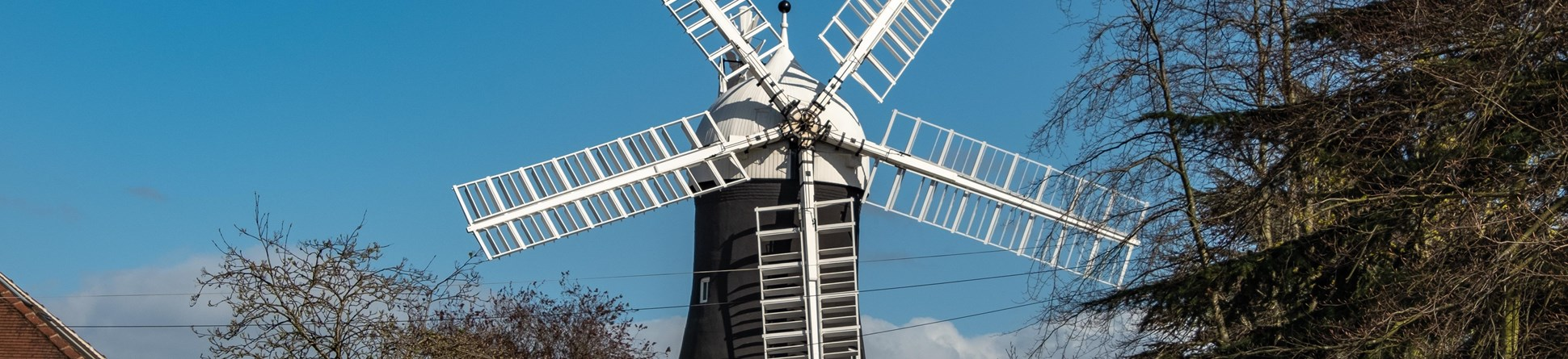 Image of Holgate Windmill, York, a tower mill which has five sails, a cap and fantail.