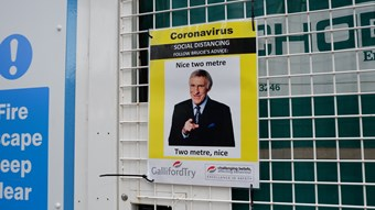 A funny health and safety sign. It includes a photo of Bruce Forsyth pointing at the viewer,between an amended version of his catchphrase 'nice two metre. Two metre nice'