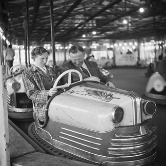 A couple driving in a dodgem car