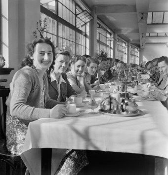 A group of people having lunch at a long table