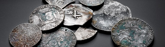 A selection of silver coins, including some snipped fragments.