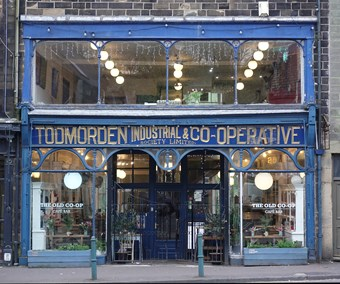 Glass shopfront with wording 'Todmorden Industrial & Co-operative Society Limited' above the door