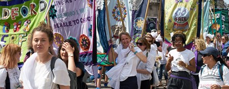 Procession of people carrying banners