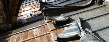 Image of the damage caused by metal theft from the roof of a historic place of worship.