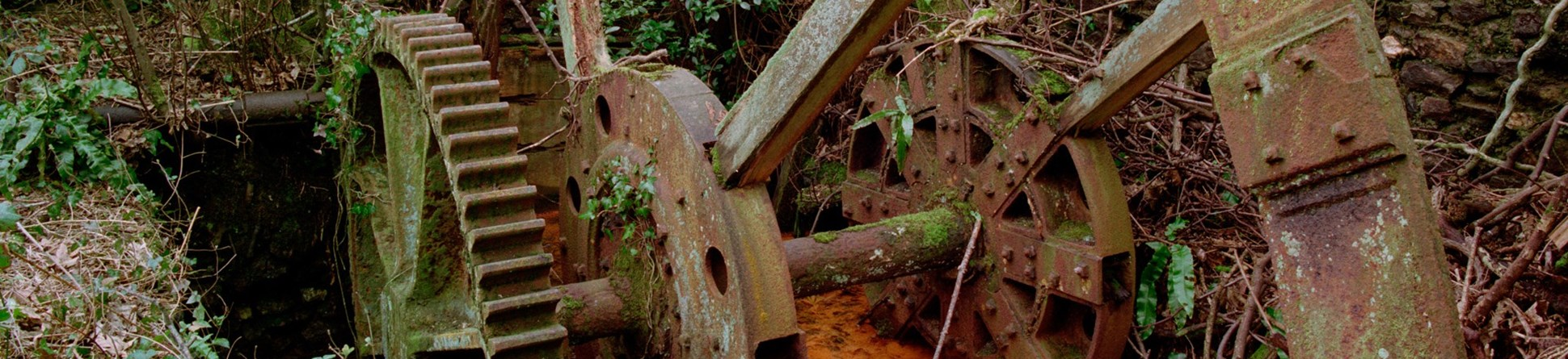 A detail photograph of rusting industrial machinery.