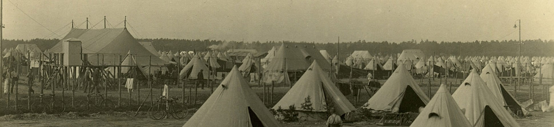 First World War Prisoner of War camp housed in canvas bell tents and large communal tents.