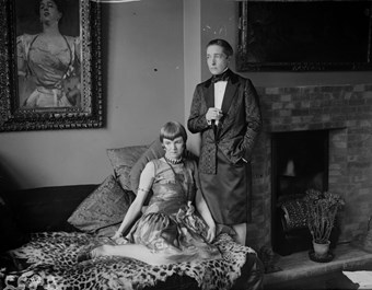 Radclyffe Hall and Una Troubridge in evening dress at their home.