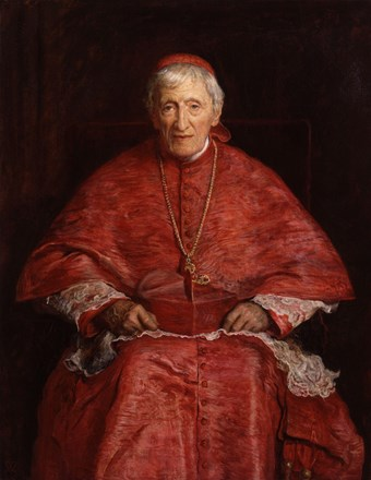 Portrait of John Henry Newman seated wearing red robes.