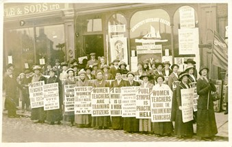 Postcard of women with equal pay placards