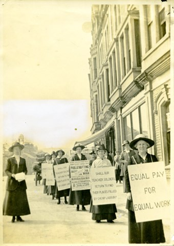 Photograph of women holding placards at NUWT equal pay demonstration